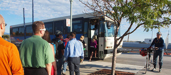 Commuters board the HX bus at East Flatiron Circle.